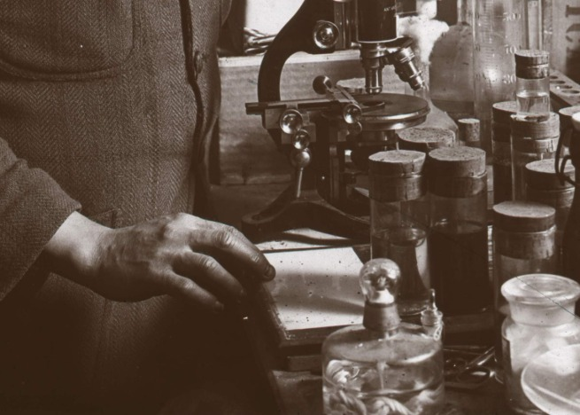 Herbert Ponting (British, 1870-1935) 'Edward Atkinson in the laboratory' (detail) 1911