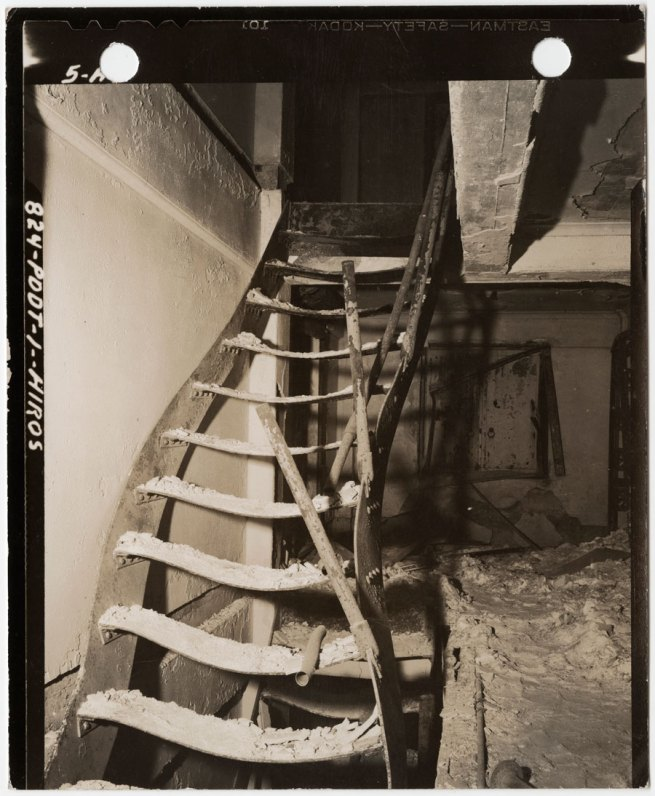 United States Strategic Bombing Survey, Physical Damage Division. '[Steel stairs warped by intense heat from burned book stacks of Asano Library,Hiroshima]' November 15, 1945