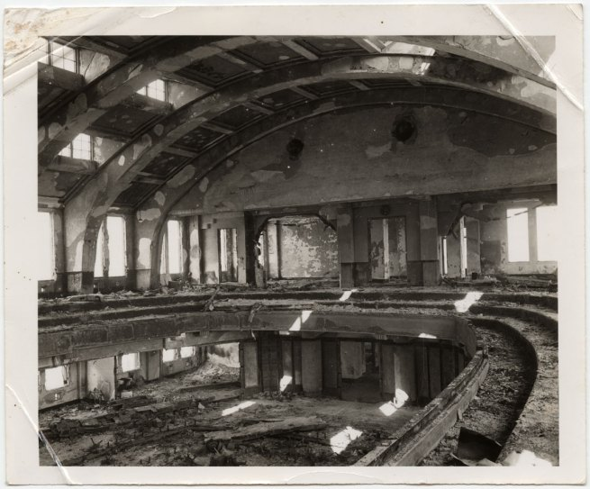 United States Strategic Bombing Survey, Physical Damage Division. '[Interior of Hiroshima City Hall auditorium with undamaged walls and framing but spalling of plaster and complete destruction of contents by fire]' November 1, 1945