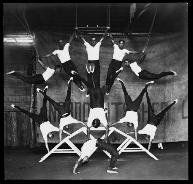 Paul Dubotzki (German, 1891-1969) 'Internees perform a breathtaking acrobatic number in the Holsworthy gym' c. 1918