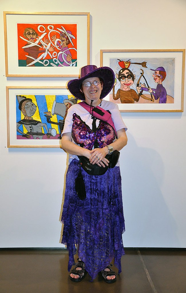 Artist Catherine Staughton standing in front of her work
