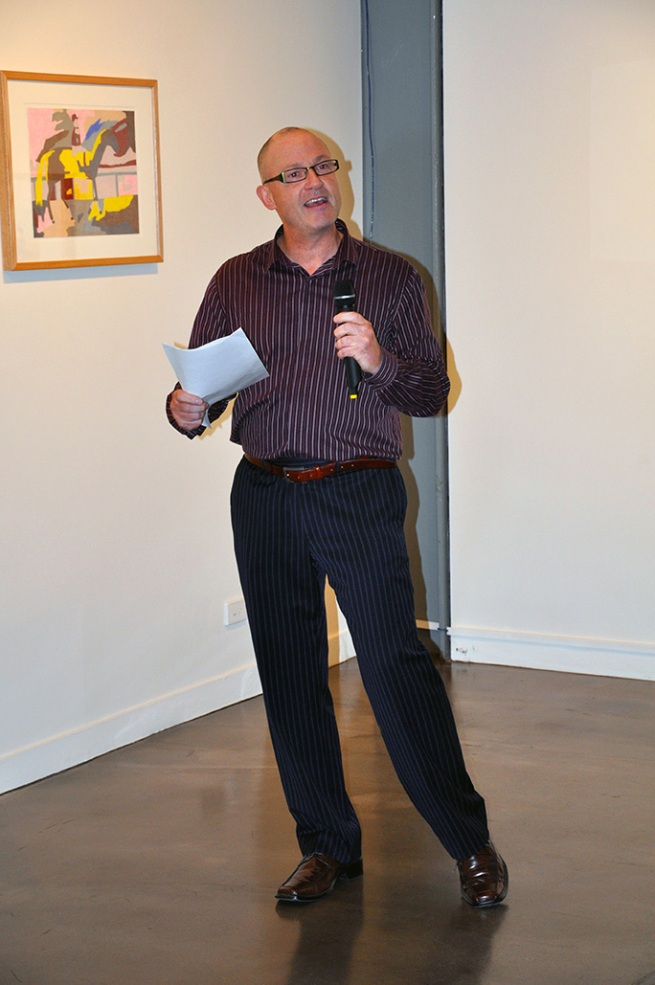 Dr Marcus Bunyan giving the opening night speech at the exhibition 'Movement and Emotion' at Arts Project Australia