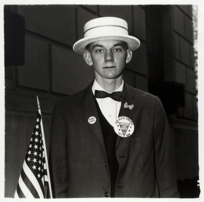 Diane Arbus. 'Boy with a straw hat waiting to march in a pro-war parade, N.Y.C. 1967' 1967