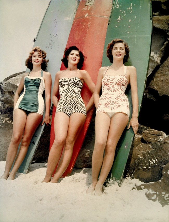 Anon. '1952 Miss Pacific finalists Mary Clifton, Pamela Jansen and Judy Worrad, stand in front of surfboards on Bondi Beach, Sydney' 1952 National Archives of Australia