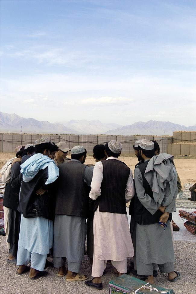 Charles Green and Lyndell Brown. 'Afghan traders with soldiers, market, Taran Kowt Base Uruzgan Province, Afghanistan' 2007 printed 2009