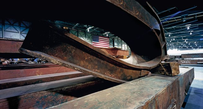 Francesc Torres. 'Twisted steel beams from ground zero dominate the space in JFK International Airport's Hangar 17, where 9/11 artifacts were housed for study and safekeeping' 2009