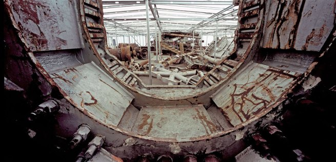 Francesc Torres. 'View through a portion of the broadcast antenna that fell from the top of the north tower. A number of fragments of the 360-foot antenna were kept at Hangar 17' 2009