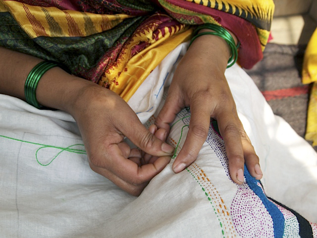 West Bengali woman embroidering the 'Disappearances'