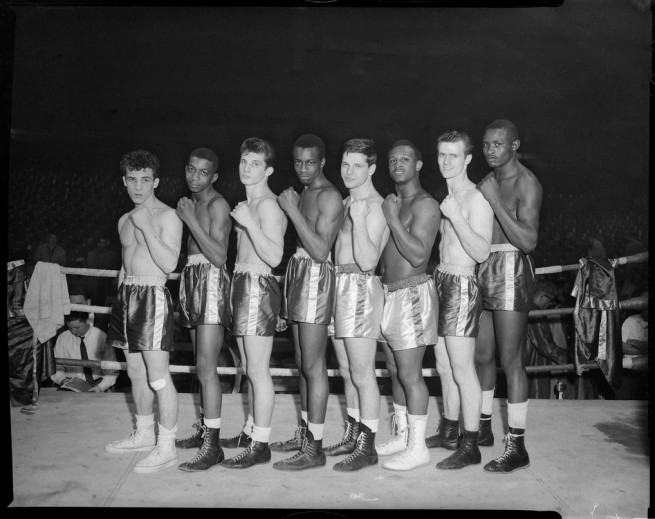 Teenie Harris. 'Group portrait of eight male boxers, possibly Golden Gloves contenders, lined up in boxing ring' c. 1955