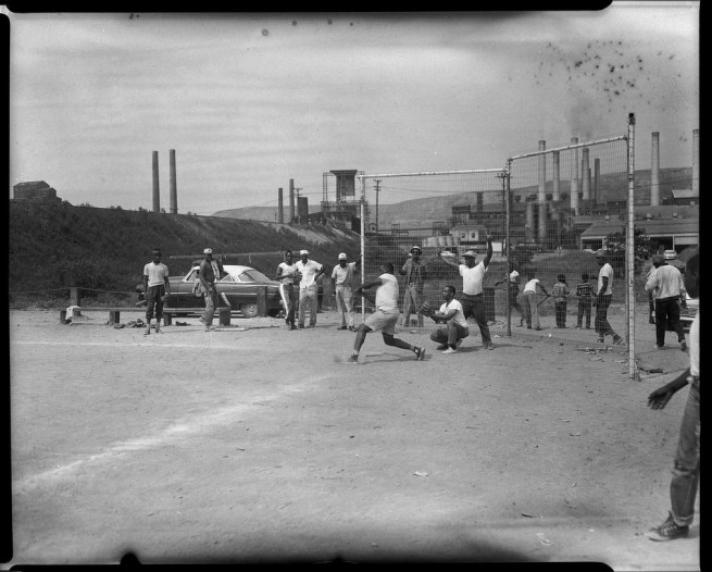 Teenie Harris. 'Young men playing sandlot baseball with steel mill in background' c. 1955