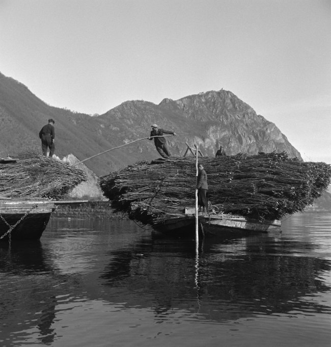 Anonymous photographer. 'Using boats to transport wood and stone on Lake Lugano' 1940. © Swiss National Museum