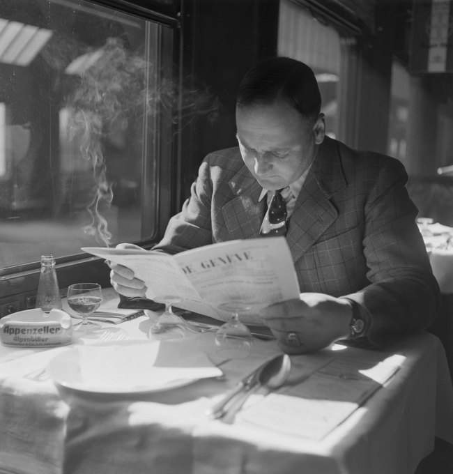 "Anonymous photographer. 'Passenger in the dining car of the ""Compagnie Suisse des Wagons-Restaurants""' c. 1940"