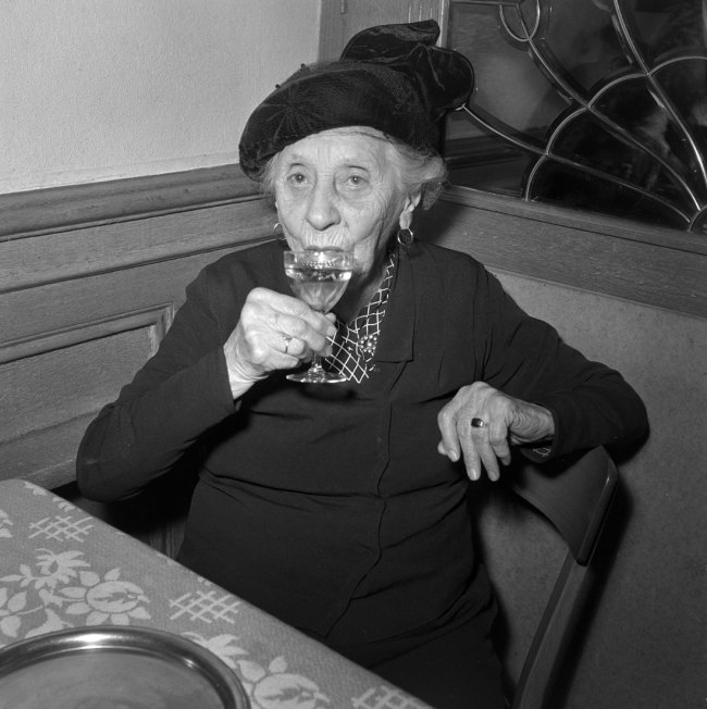 Anonymous photographer. 'Elderly lady in a restaurant, Lausanne' 1959