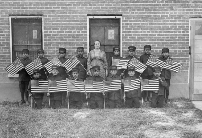 Photographer unknown. 'Albuquerque Indian School Boys with Flags' c. 1900