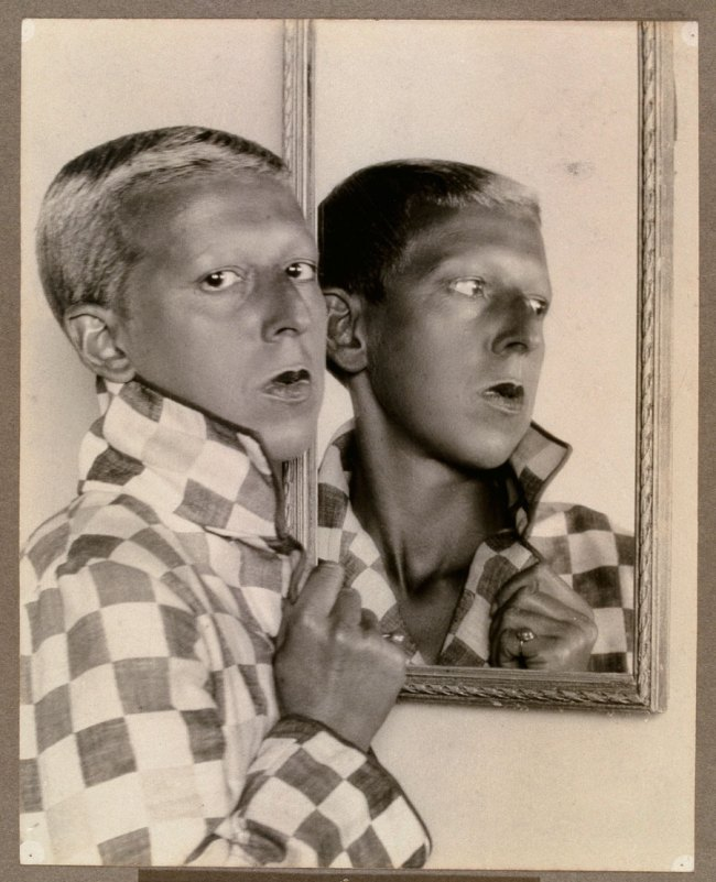 Claude Cahun (French, 1894-1954) 'Self-portrait (reflected image in mirror with chequered jacket)' 1927