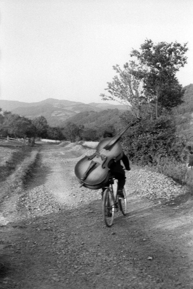Henri Cartier-Bresson (French, 1908-2004) 'Serbia. Bass player on the road Belgrade-Kraljevo, to play at a village festival near Rudnick' Yugoslavia 1965