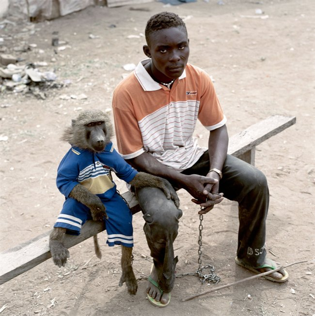 Pieter Hugo. 'Dayaba Usman with the monkey Clear, Abuja' From the series 'The Hyena & Other Men' 2005-2007
