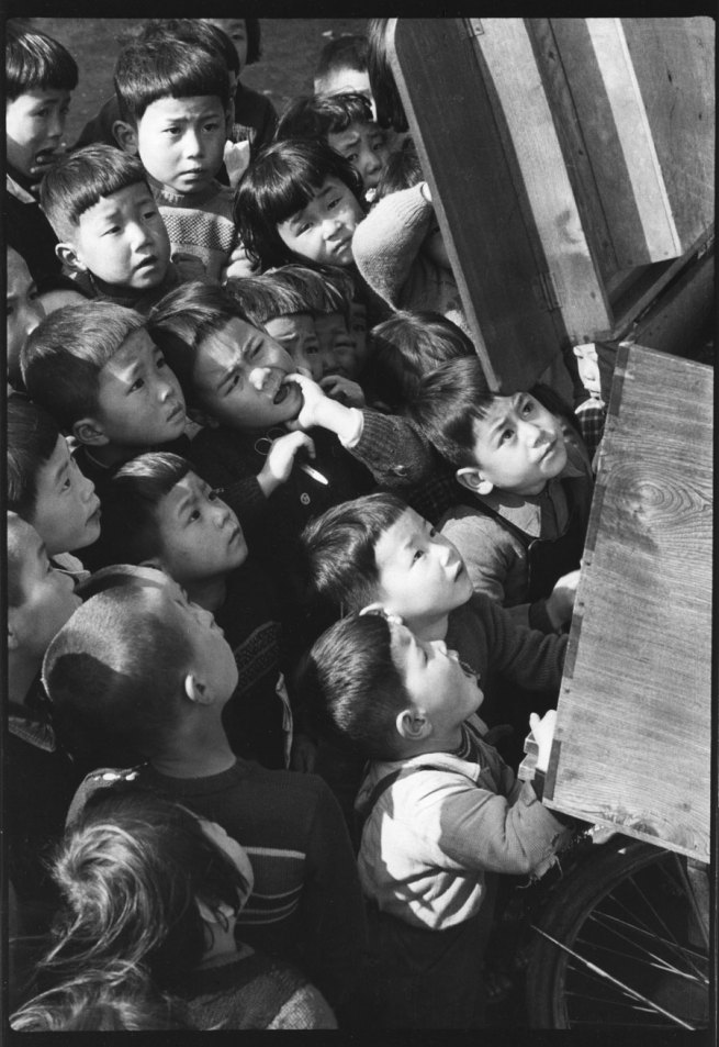 Ken Domon. 'Children looking at a picture-card show' Tokyo 1953