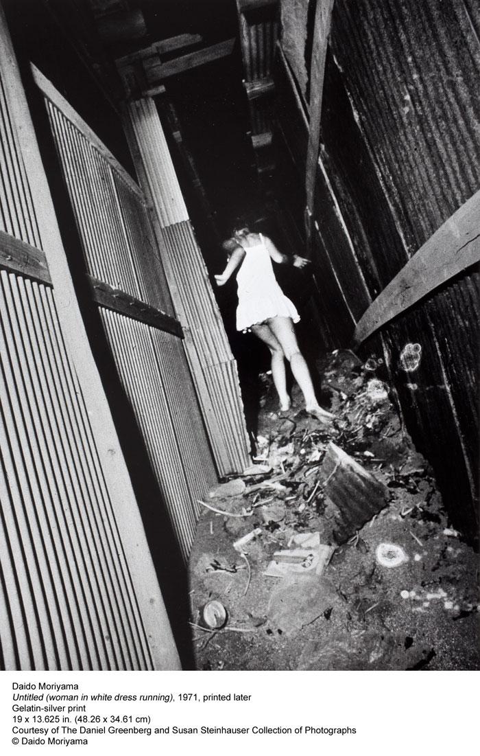 Daido Moriyama. 'Untitled (woman in white dress running)' 1971