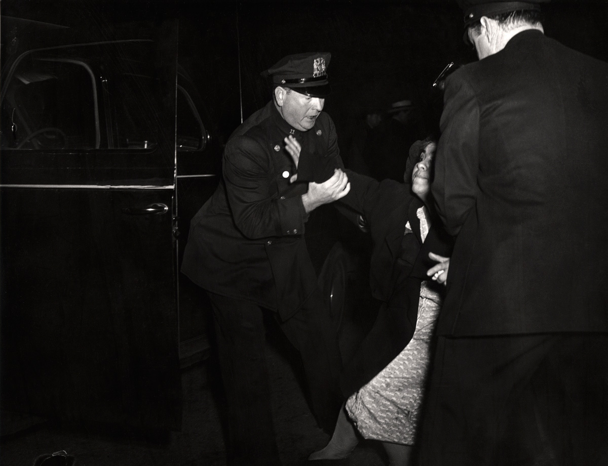 Weegee. 'The dead man's wife arrived...and then she collapsed' ca. 1940