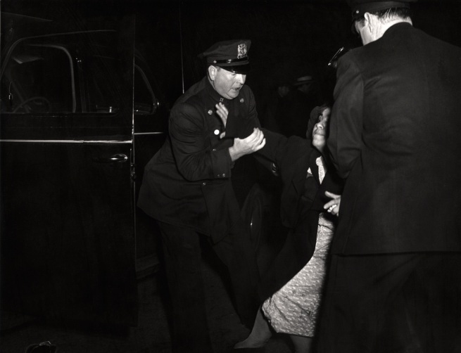 Weegee. 'The dead man's wife arrived...and then she collapsed' c. 1940