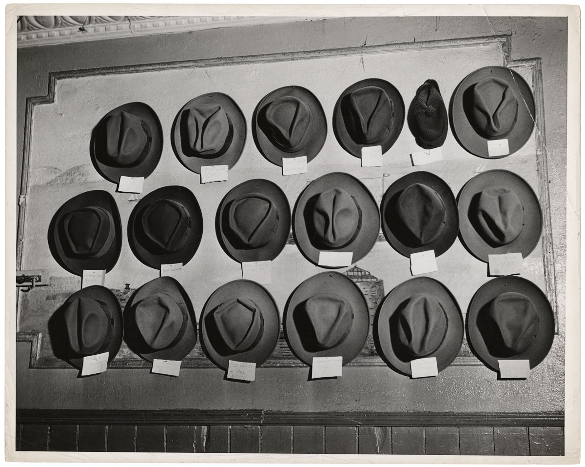 Weegee. 'Untitled [Hats in a pool room, Mulberry Street, New York]' ca. 1943