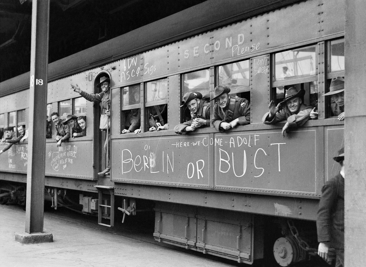 S Hood. '6th division AIF troops waving from troop-train carriage, 13 September 1940' 1940