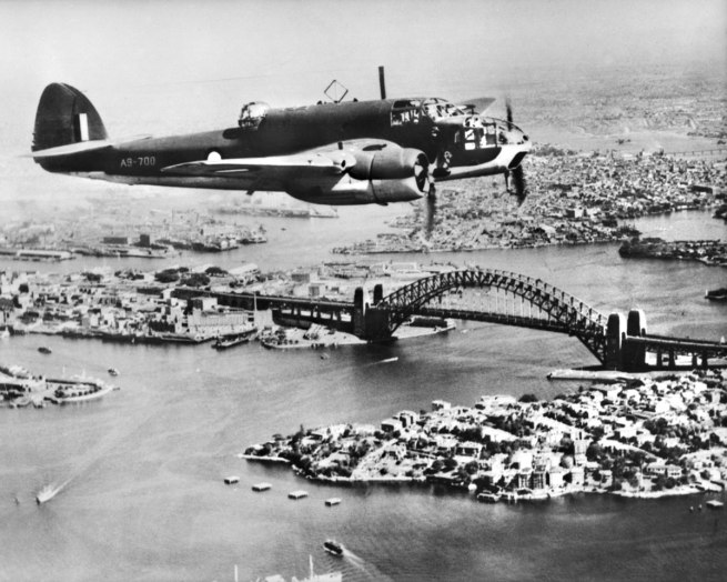 Anonymous photographer. 'An Australian built DAP Bristol Beaufort VIII aircraft, serial no A9-700, in flight over Sydney Harbour near the Bridge' c. 1944