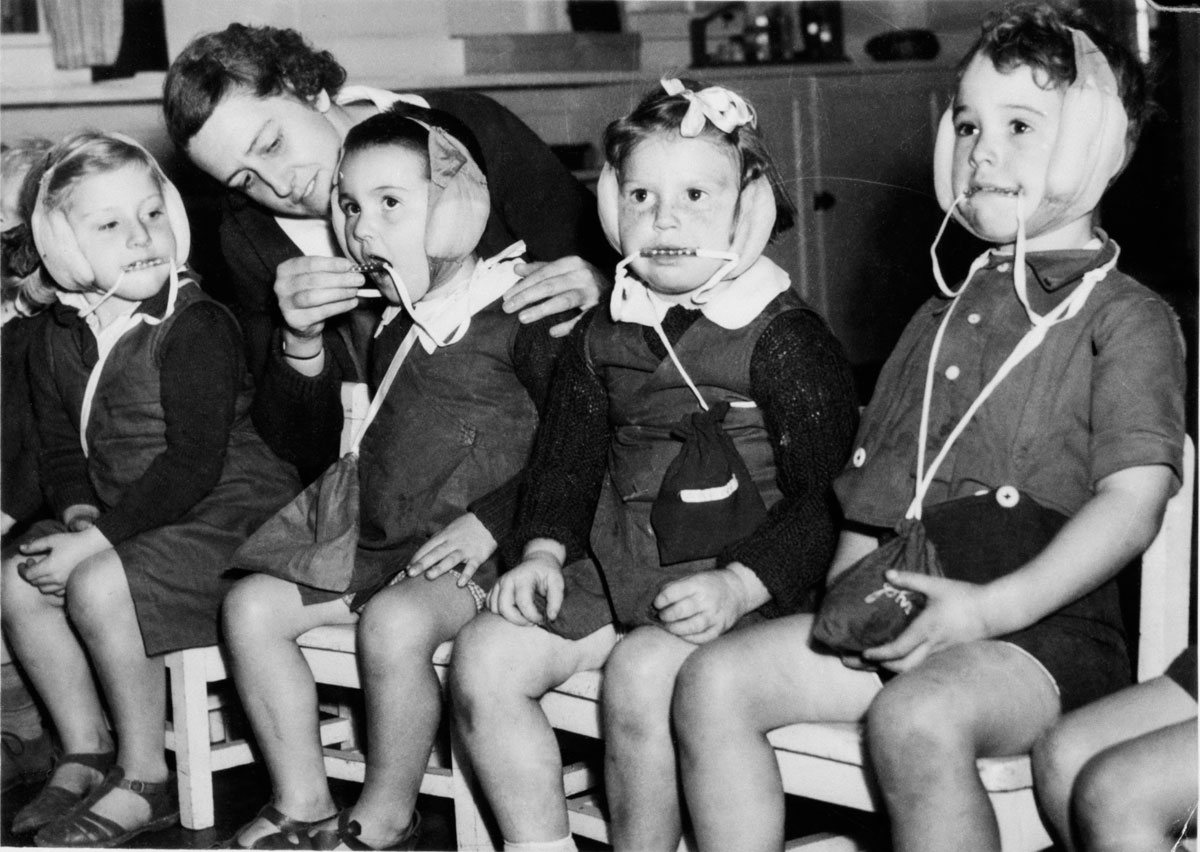 Anon. 'Sydney kindergarten children wearing air raid headgear designed to muffle sounds and prevent them from biting tongues' Nd