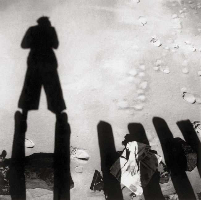 Eva Besnyö. 'Untitled [The shadow of John Fernhout, Westkapelle, Zeeland, Netherlands]' 1933