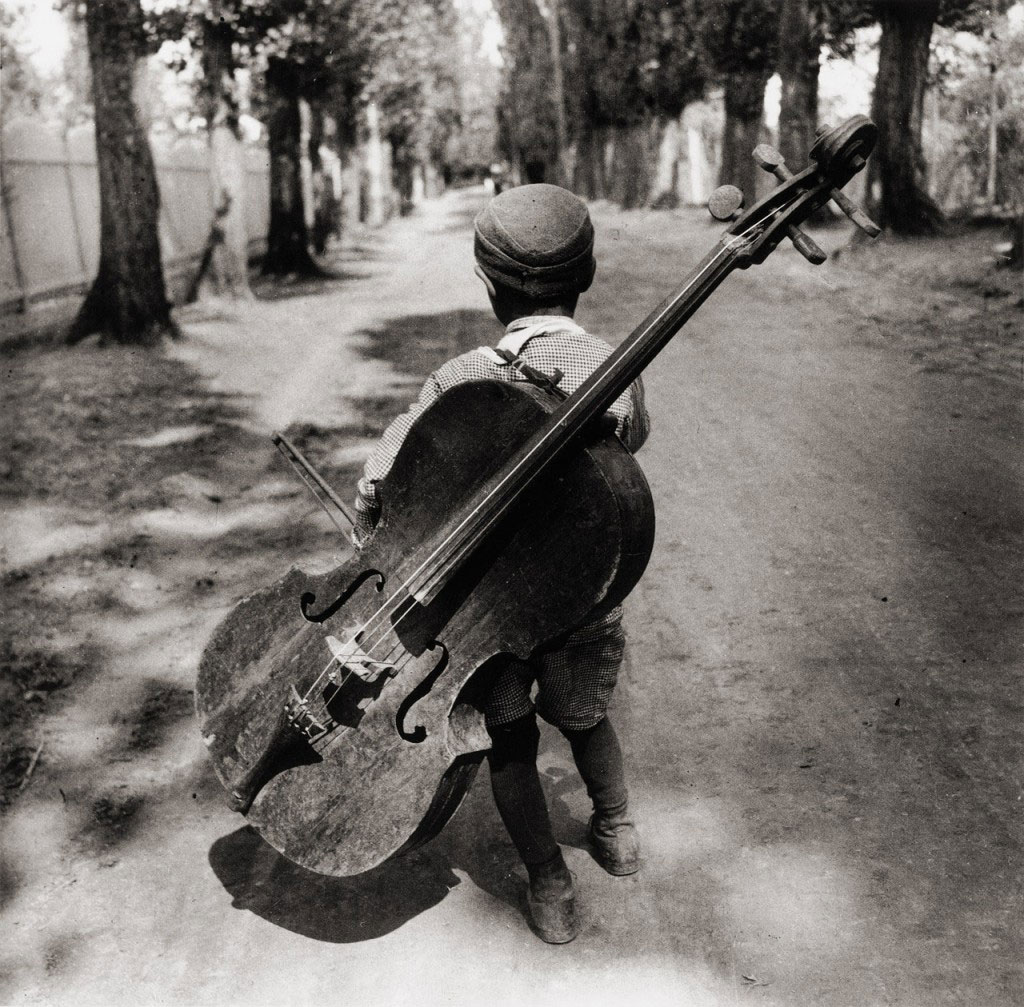 Eva Besnyö. 'Untitled Untitled [boy with a violoncello, Balaton, Hungary]' 1931