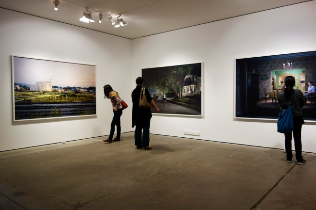 Installation photographs the series 'Beneath the Roses' (2003-2008) from the exhibition 'Gregory Crewdson: In A Lonely Place' at the Centre for Contemporary Photography (CCP), Fitzroy, Melbourne