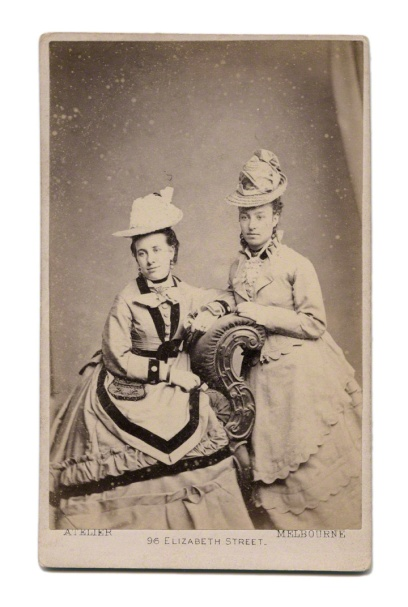 J. R. Tanner. 'Untitled [Two woman wearing elaborate hats]' 1875