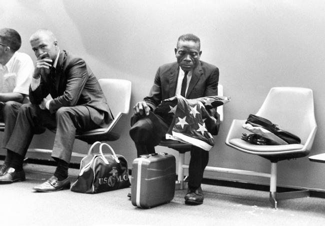 Harry Benson. 'Grieving man, holding flag' 1971