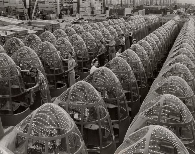 Alfred Palmer (American) 'Women aircraft workers finishing transparent bomber noses for fighter and reconnaissance planes at Douglas Aircraft Co. Plant in Long Beach, California' 1942