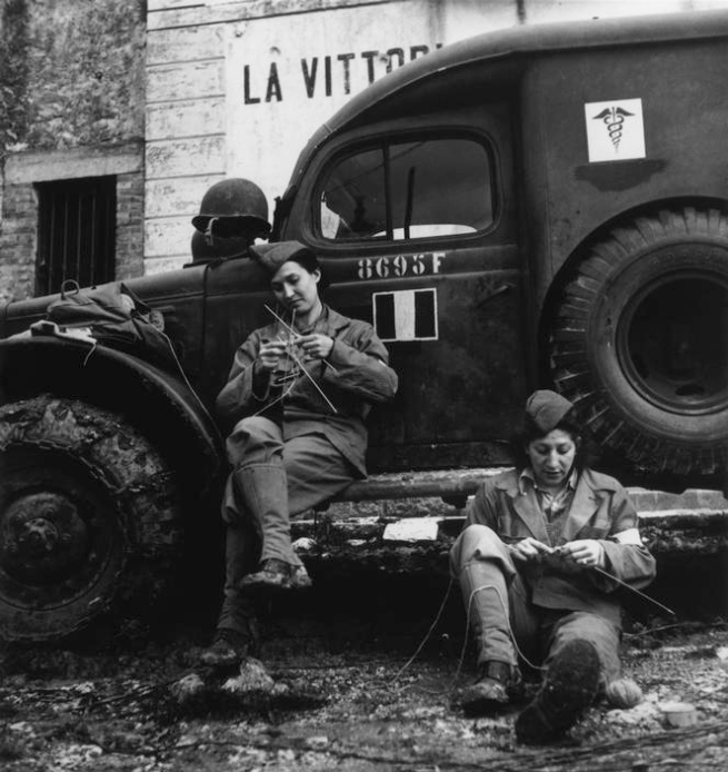 Robert Capa (1913-1954) 'Drivers from the French ambulance corps near the front, waiting to be called' Italy, 1944