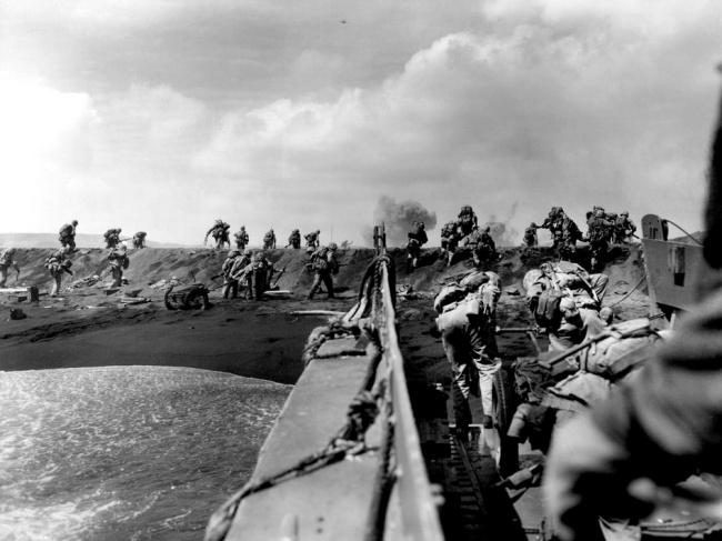 Joe Rosenthal, American (1911-2006) 'Over the Top - American Troops Move onto the Beach at Iwo Jima' February 19, 1945