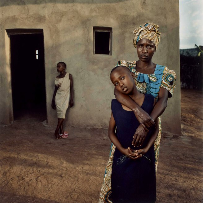 Jonathan C. Torgovnik (American, b. 1969) 'Valentine with her daughters Amelie and Inez, Rwanda' 2006