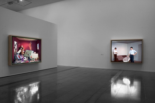 Installation view of 'Jeff Wall Photographs' at NGV Australia showing, at left, 'The Destroyed Room' 1978, and at right, 'Double Self-Portrait' 1979
