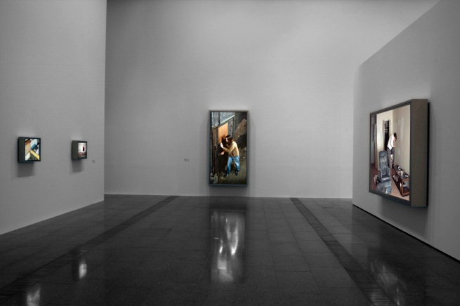 Installation view of 'Jeff Wall Photographs' at NGV Australia showing, at centre, 'Doorpusher' 1984, and at right, 'Polishing' 1998