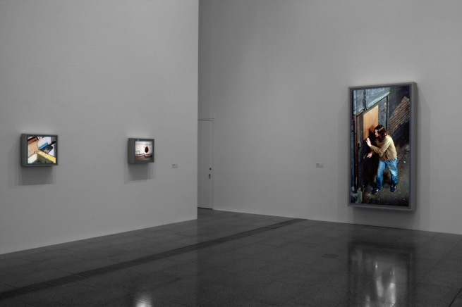 Installation view of 'Jeff Wall Photographs' at NGV Australia showing, at left, 'Diagonal Composition' 1993, and at right, 'Doorpusher' 1984