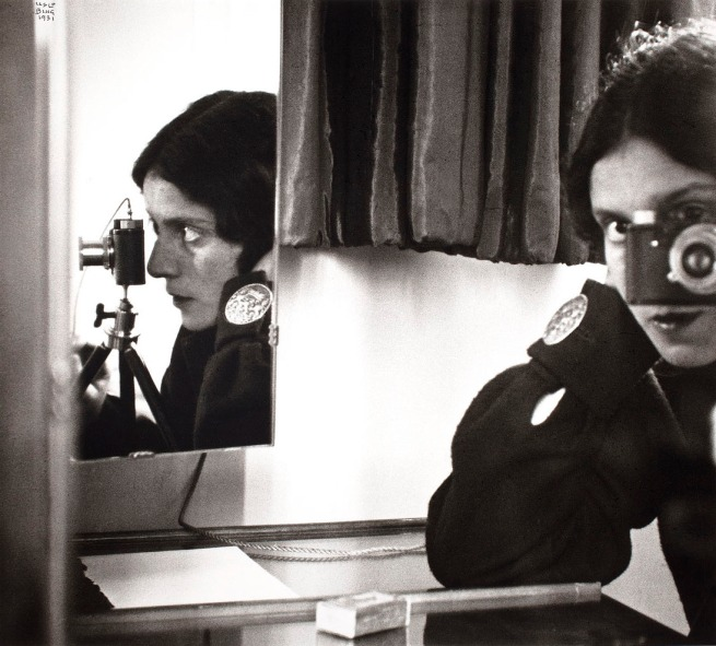 Ilse Bing. 'Self-Portrait with Leica' 1931 gelatin silver print, printed c. 1988
