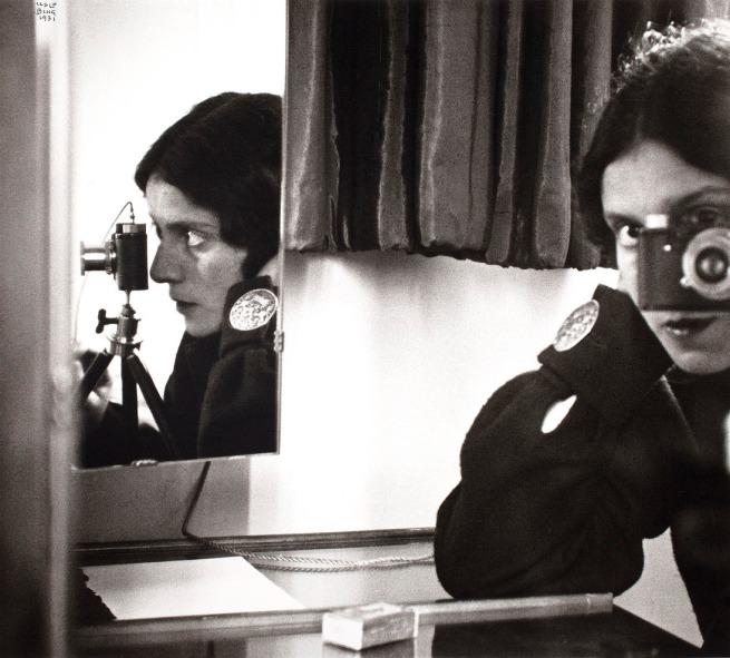 Ilse Bing. 'Self-Portrait with Leica' 1931 gelatin silver print, printed c. 1988
