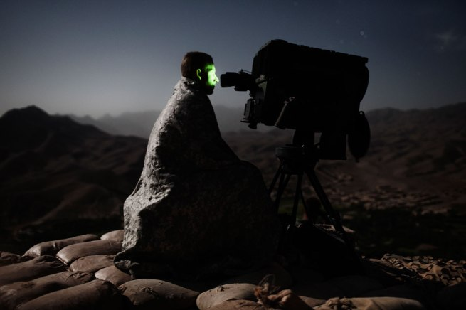 Adam Ferguson. 'September 4, Tangi valley, Wardak province, Afghanistan, a soldier of the U.S. Army 10th Mountain Division was  attentively monitoring a highway' September 4, 2009