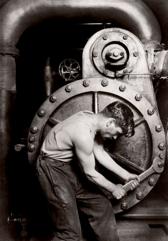 Lewis Hine. 'Mechanic at steam pump in electric power house' 1920