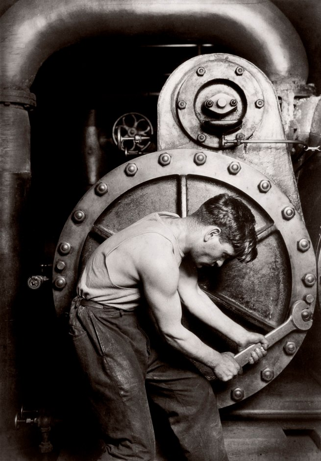 Lewis Hine. 'Powerhouse mechanic working on steam pump' 1920