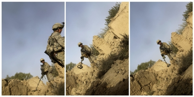 João Silva. 'Soldiers of Charlie Company, 1st Battalion, 66th Armored Regiment, 4th Infantry Division react to photographer Joao Silva stepping on a mine in the Arghandab district of Kandahar Province, Afghanistan, on Oct. 23, 2010'