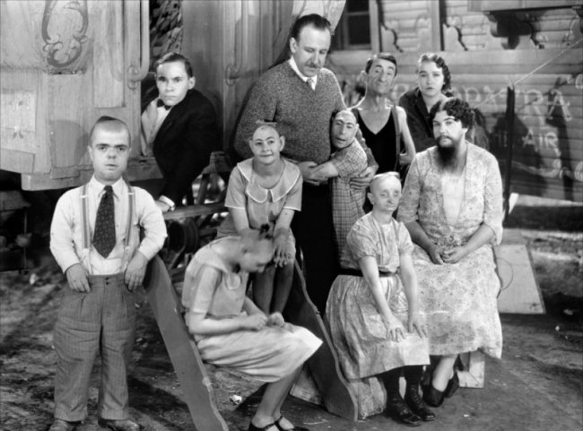 Tod Browning (director) 'Publicity photo for Freaks, featuring much of the cast with director, Tod Browning' 1932