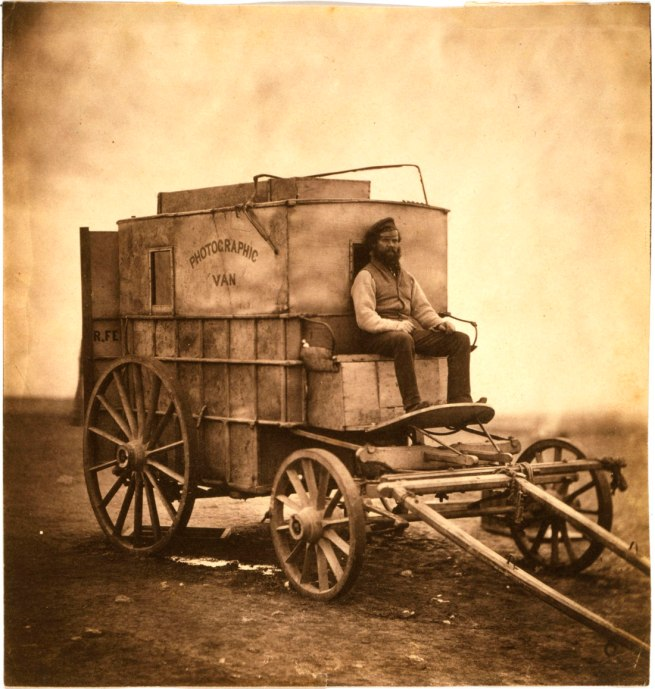 Roger Fenton (English, 1819-1869) 'The artist's van [Marcus Sparling, full-length portrait, seated on Roger Fenton's photographic van]' 1855