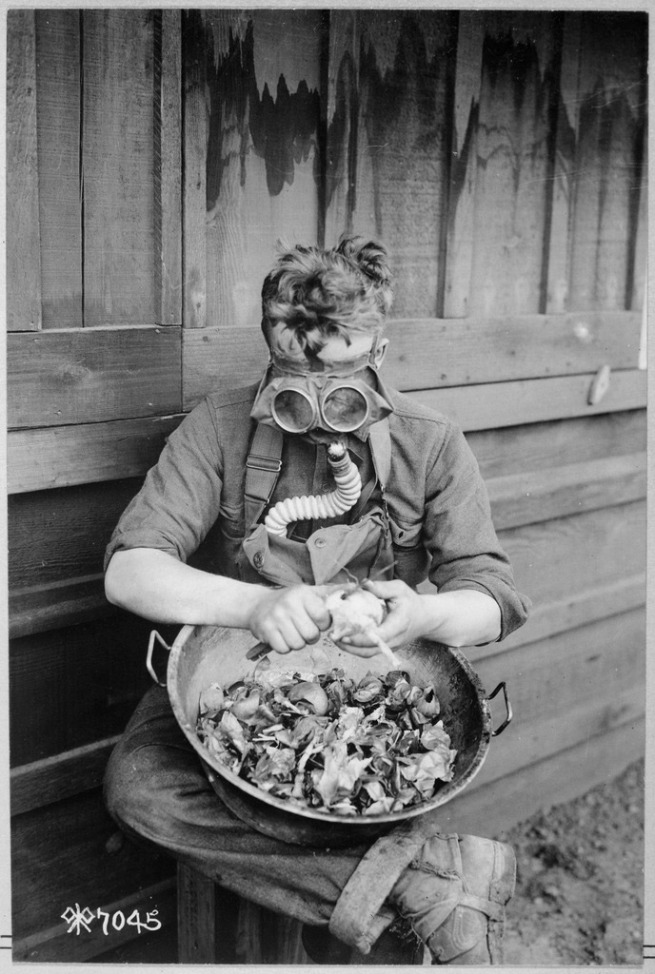 Anonymous photographer. 'Soldiers trying out their gas masks in every possible way. Putting the respirator to good use while peeling onions. 40th Division, Camp Kearny, San Diego, California' 1918